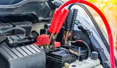 78337747-charging-car-battery-with-electricity-trough-jumper-cables-red-and-black-jumper-cables